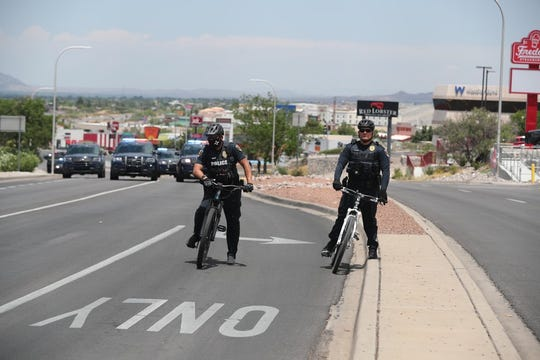 Las Cruces police officers stand watch as protesters take over the Telshor Boulevard-Foothills Road intersection on Saturday, June 13, 2020.