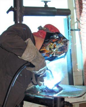 DACC Welding Fabrication Class former student Abbey Seward works on a welding project.