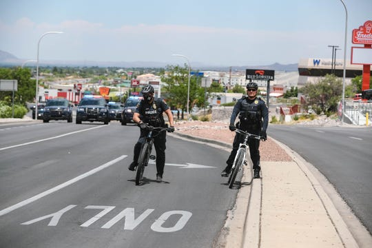 Police wait and watch as demonstrators gather to protest police brutality, blocking Telshor Blvd and Foothills Road near Hotel Encanto in Las Cruces on Saturday, June 13, 2020.