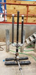 Students from New Mexico State University's Aggie Without Limits have been working to improve the efficiency of hydraulic ram pumps to provide residents of Oyanca, Nicaragua with potable water. Pictured here is the original ram pump with steel air chambers.