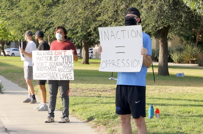Protesters outside the Eddy County Courthouse in Carlsbad, New Mexico call for an end to racial injustice on June 12, 2020. This is one of several protests this group plans on having in the month of June.