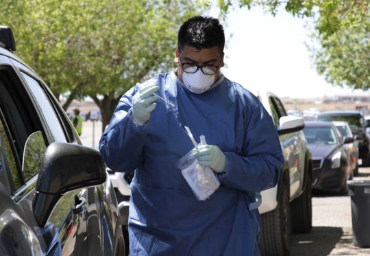 Health care professionals from the National Guard, Northern Navajo Medical Center and San Juan County Public Health Office collected samples from individual at the free testing site for COVID-19 on May 5 at Shiprock High School in Shiprock.
