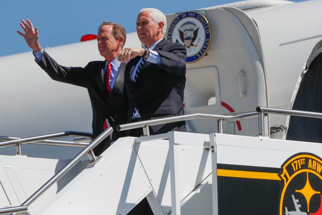 Vice President Mike Pence, right, and Sen. Pat Toomey, R-Pa., wave as they arrive at the 171st Air Refueling Wing base, Friday, June 12, 2020, in Imperial, Pa. (AP Photo/Keith Srakocic)