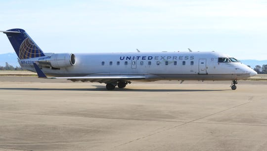 A United Express jet filled with passengers waits for permission to depart from Redding Municipal Airport on Friday, Jan. 31, 2020.