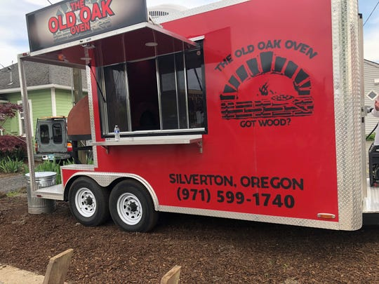 At The Old Oak Oven in Silverton, Gerald Williams serves wood-fired pizzas, both whole and by the slice.