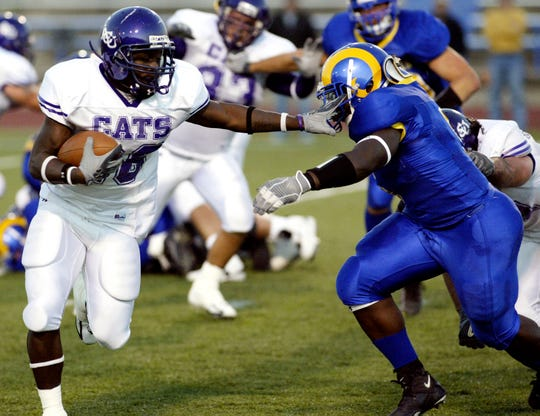 Angelo State's Tyrell McCrea looks to tackle Abilene Christian's Taber Minner during a game Oct. 8, 2005.