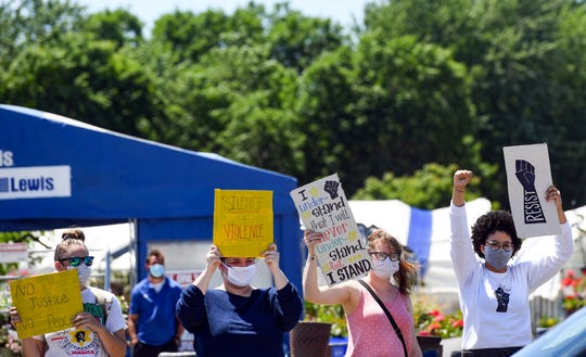 Protesters participate in the third protest against racism and police brutality in the aftermath of George Floyd's death on Saturday, June 13, in Sioux Falls.