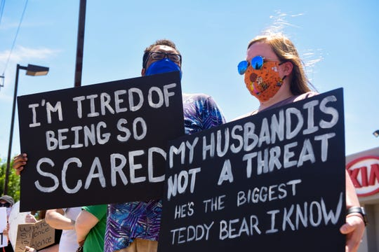 Spouses Mason Calhoun and Taryn Hogarth participate in the protest against racism and police brutality in the aftermath of George Floyd's death on Saturday, June 13, on Minnesota Avenue in Sioux Falls. Calhoun is Black and Hogarth is white.