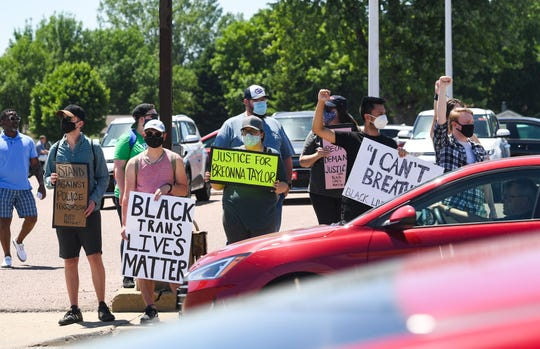 Cars drive past protesters on Minnesota Avenue during the third protest against racism and police brutality in the aftermath of George Floyd's death on Saturday, June 13, in Sioux Falls.