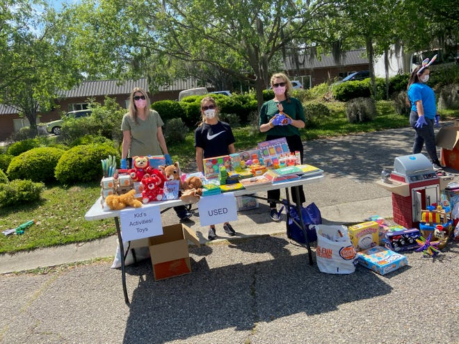 Hang Tough Foundation volunteers at Supply Drive-Thru pick-up events for their Hero Families.