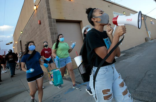 Amaya Flores leads a chant as the El Paso March for Criminal Justice Reform Friday. The group of about 50 made their way from Memorial Park to El Paso Police Headquarters.