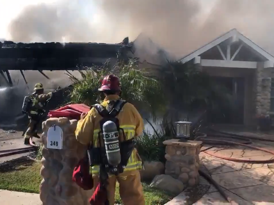 An image from a video showing Ventura County firefighters attacking a garage fire that spread to the attic and an RV in Thousand Oaks Friday, June 12, 2020.