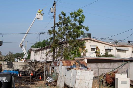 Tree pulls down power lines and starts fire on Paradise Street south of Tulare Avenue on Friday, June 12, 2020.