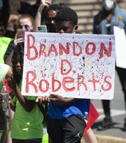 """Brandon's Life Matter"" march participants march to Milford's City Hall on Saturday, June 13, in Milford, Del."