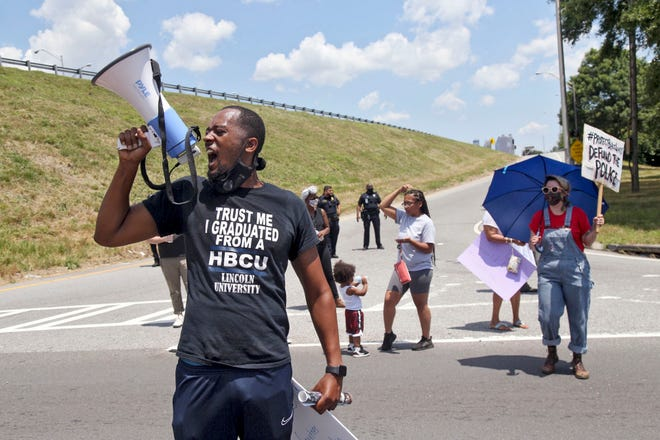 Protestors block University Avenue and the onramp to I-75 northbound near the Wendy's fast food restaurant in Atlanta on Saturday,  June 13, 2020, where Rayshard Brooks, a 27-year-old Black man, was shot by Atlanta police Friday evening during a struggle in a drive-thru line.