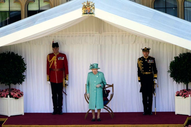 Britain's Queen Elizabeth II attends a ceremony to mark her official birthday at Windsor Castle in Windsor, England, Saturday June 13, 2020. Queen Elizabeth II's birthday is being marked with a smaller ceremony than usual this year, as the annual Trooping the Color parade is canceled amid the coronavirus pandemic.