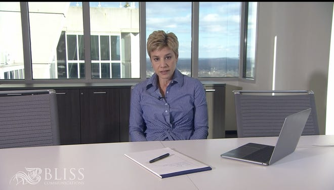 Communications expert Mimi Bliss says to use your hands in a meeting. Don't slouch