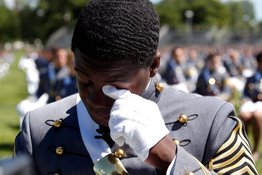 West Point Class President Joshua Phillips, from Chicago, wipes a tear during the U.S. Military Academy's commencement ceremony on June 13, 2020.