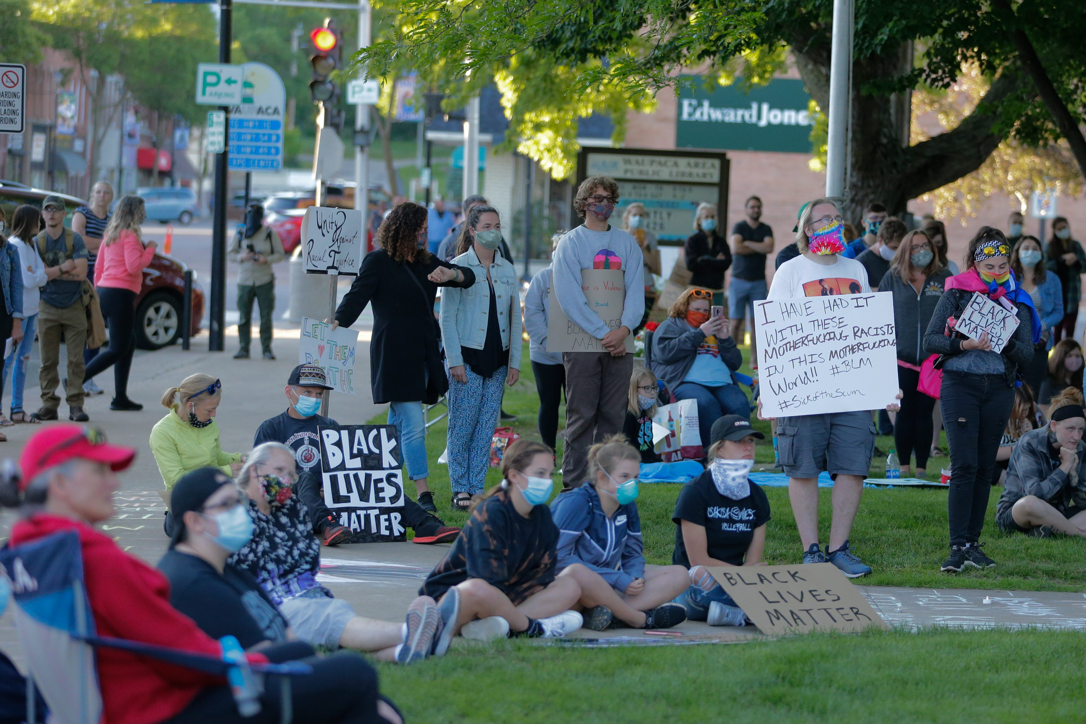 People participate in a Black Lives Matter protest Saturday, June 13, 2020, in Waupaca, Wis. Alex Martin/USA TODAY NETWORK-Wisconsin