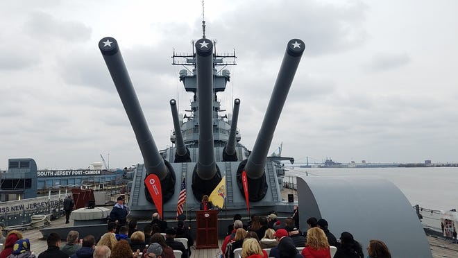 Guns of two of the main turrets of the Battleship Jersey loom over its forward deck in Camden, where the ship is moored as a museum on the Delaware River.