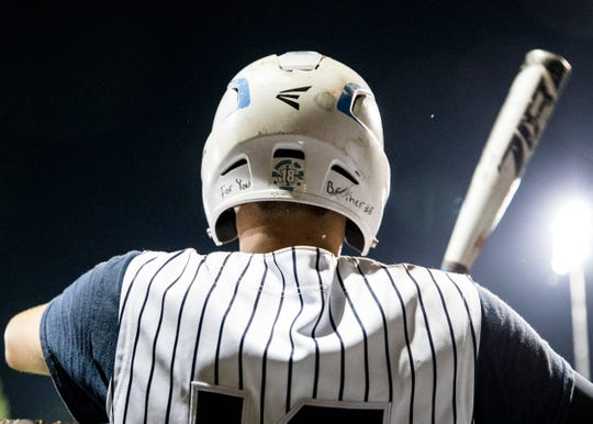 """Ethan Kunkel has """"For You Brother"""" in his helmet as Adena  defeated Fairland 11-0  in a Division III district semifinals game on Thursday, May 23, 2019, at the VA Memorial Stadium in Chillicothe, Ohio."""