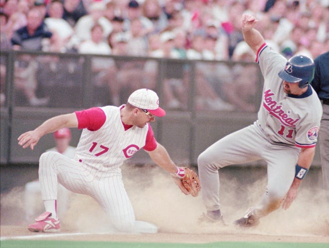 Montreal Expos' Shane Andrews tries to avoid a tag against Cincinnati Reds third baseman Chris Sabo during a game on June 15, 1996 in Cincinnati. Andrews' 1996 season was Andrews' second season in the MLB and was one of his most productive.
