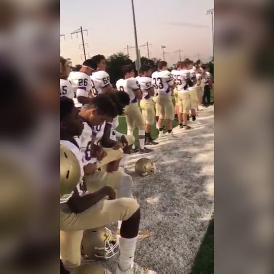 Kaylon Bradley and three Monroe High School teammates took a knee during the playing of the national anthem during a Sept. 28, 2017 game.
