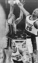 Vinnie Johnson hits the winner over Jerome Kersey in Game 5.