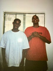 McKenzie Cochran of Ferdale, ( left) poses in this undated photo with his brother, Michael Cochran, who is  hoping the Black LIves Matter movement helps reopen his brother's case. McKenzie died in 2014 after mall security officers held him on the floor during an arrest.  No one was charged.