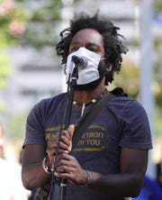 Tristan Taylor talks to several hundred protesters gathered to march against police brutality on Michigan Avenue and Third Avenue in Detroit, Saturday, June 13, 2020. The group split up going downtown and a smaller group marching to SW Detroit.