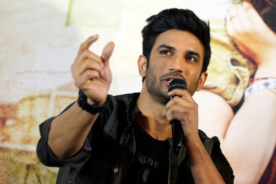 """In this May 30, 2017 file photo, Bollywood actor Sushant Singh Rajput speaks during a press conference to promote his  movie """"Raabta"""" in Ahmadabad, India."""
