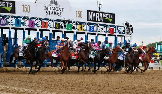 Horses break from the starting gate at the start of the 2018 Belmont.