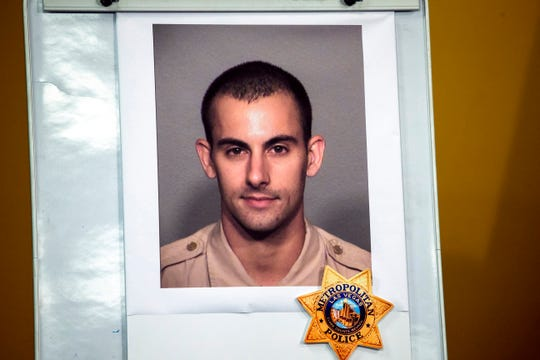 A photo of Las Vegas police officer Shay K. Mikalonis, 29, a four-year veteran of the department, is displayed during a media briefing June 2 Tuesday at police headquarters in Las Vegas