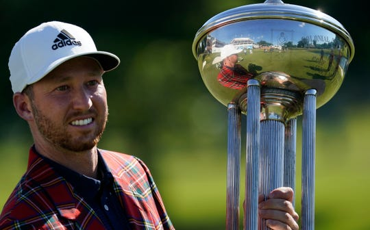Daniel Berger poses with the championship trophy after winning the Charles Schwab Challenge golf tournament after a playoff round Sunday at the Colonial Country Club in Fort Worth, Texas