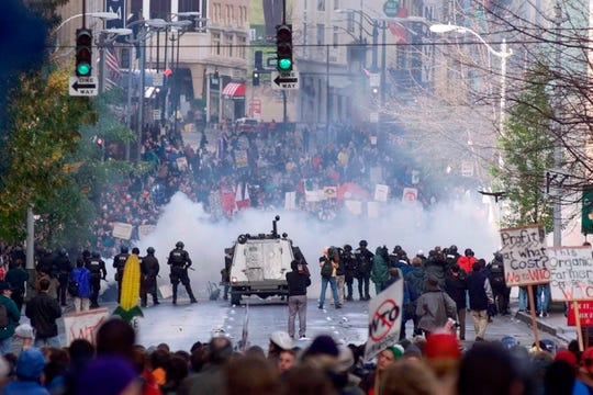 Seattle police use tear gas to push back World Trade Organization protesters in downtown Seattle in 1999. Seattle has a long history of demonstrations, stretching back to labor movements before World War I.