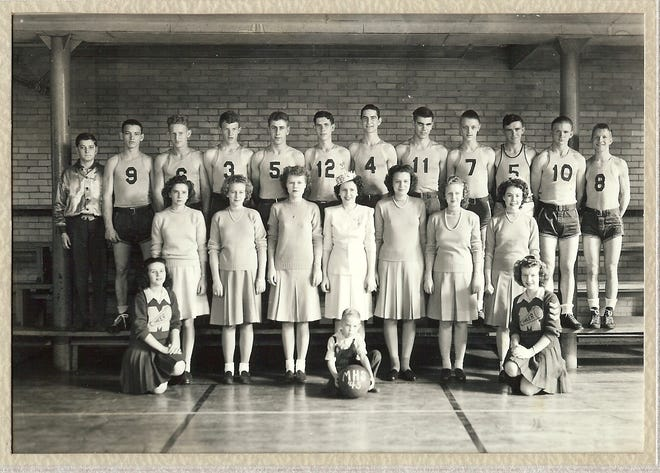 """The 1945-46 Mackey High School basketball team and the school's """"Queen's Court"""" for that season. Cheerleaders: Carolyn Obert, sister of Winfrid Obert #12 and Ruth Skelton; Mascot with Ball: James """"Jimmy"""" Skelton, nephew of Ruth Skelton; Queen and attendants- l-r Unknown,  Eualee Wilson, Mary Montgomery, Queen Iola Tyring, Alma Jean Annis, Bernice Lee Richey, Unknown; basketball team, from left, Jack Burch, Team Manager, Alton """"Smokey"""" Ambrose #9, Charles """"Chris"""" Schmett #6, Louis Buck,#3, Arthur """"Archie"""" Wildt,#5, Winfrid Obert #12, Erwin Dee """"Dee"""" Whitehead #4, Wayne Benton #11, Robert """"Bob"""" Block #7, Marvin McConnell #5. Donald """"Don"""" Lutz #10, Clifford """"Casey"""" Bennett #8 ."""