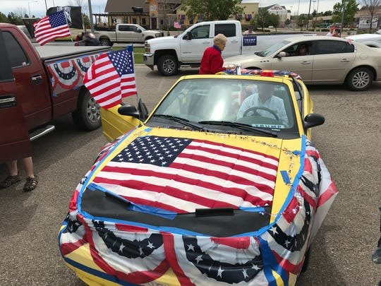 Residents decorated their vehicles with flags and signs during a parade to celebrate President Trump's birthday.