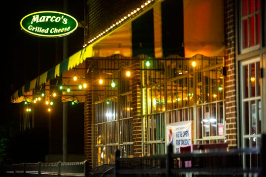Lights hang from the yellow and green awning outside Marco's Grilled Cheese, Saturday, June 13, 2020, at 117 N. Linn Street in Iowa City, Iowa.