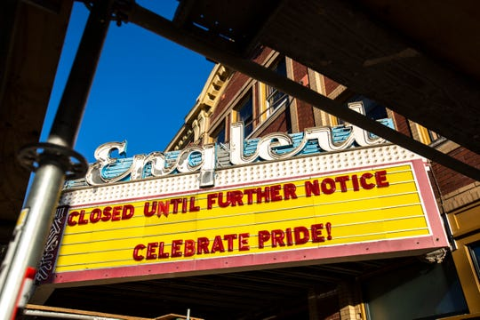 "The marquee at the Englert Theatre reads, ""Closed until further notice,"" and ""Celebrate Pride!"" as construction continues during a renovation project, Friday, June 12, 2020, in Iowa City, Iowa."