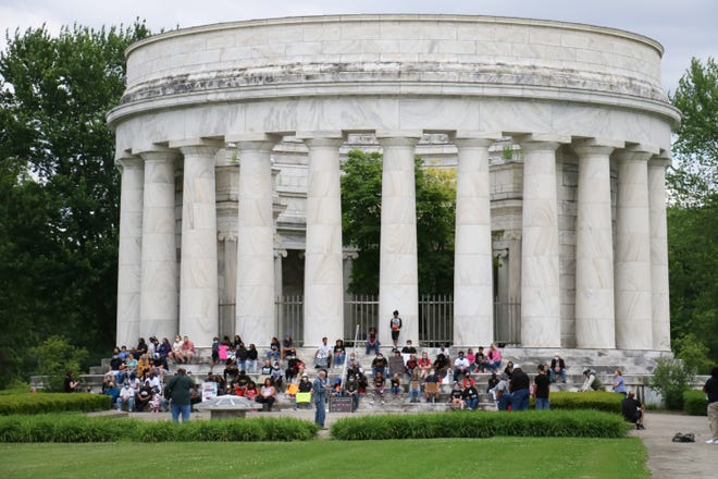 In memory of George Floyd, the Minnesota man whose death while in police custody has sparked international protests against racism and police brutality, a crowd sits silent on Saturday, June 123 2020, at the Harding Memorial in Marion.