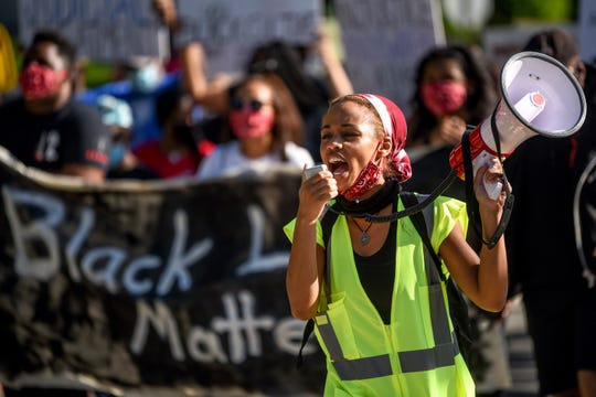 Black Lives Matter Morristown and Wind of the Spirit kick off their Summer Series with a walk from Madison to Florham Park on Saturday June 13, 2020. Anijah Slusser leads the march with a megaphone.