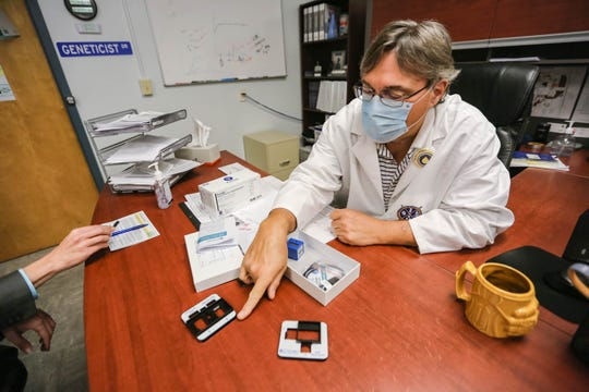 Stefan Long, the chief operating officer of Vanguard Genetics and Alliance DNA Laboratory, shows a portable testing kit that tests for COVID-19 antibodies in his laboratory on the campus of New Mexico State University in Las Cruces on Friday, June 14, 2020.