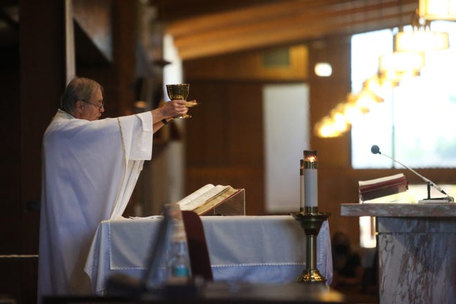 Monsignor Howard Lincoln during mass at Sacred Heart Catholic Church in Palm Desert last year.