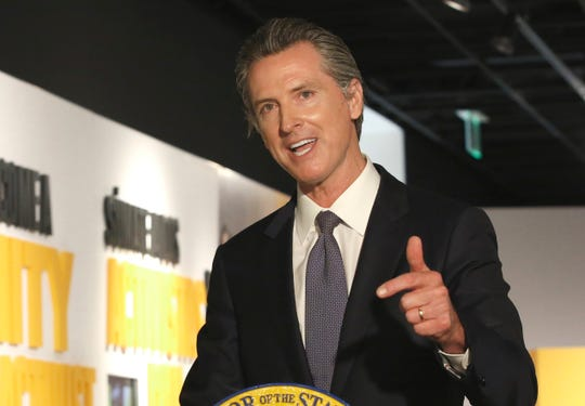 In this June 5, 2020, file photo Gov. Gavin Newsom speaks during a news conference in Sacramento. A California judge is ordering Newsom to stop issuing orders that might be interpreted as usurping the Legislature's responsibilities at least until a hearing in two weeks. Republican lawmakers said the preliminary ruling Friday, June 12, 2020, reinforces the separation of powers.