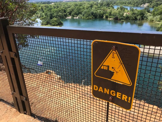 A teenager fell down a 100-foot cliff after he climbed over a fence near the bluffs overlooking the Sacramento River in Redding. In some places the fence is just a few feet from the cliff.
