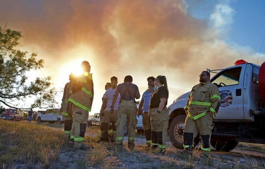 Firefighters with the Robert Lee Volunteer Fire Department monitor activity on the McDaniel Fire burning northwest of San Angelo on Saturday, June 13, 2020.