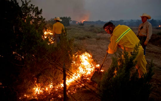 First responders work on the McDaniel Fire burning northwest of San Angelo on Saturday, June 13, 2020.