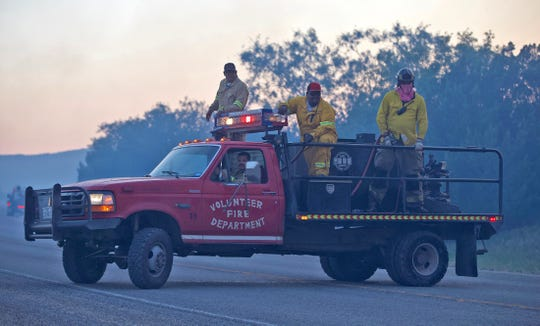 Firefighters with the Robert Lee Volunteer Fire Department work on the McDaniel Fire burning northwest of San Angelo on Saturday, June 13, 2020.