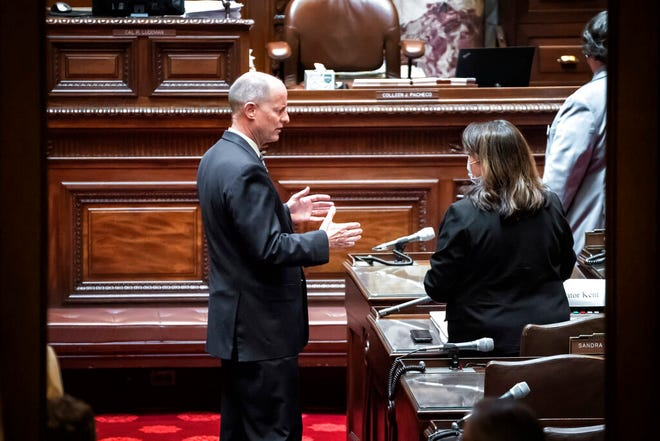 Senate Majority Leader Paul Gazelka, R-Baxter talks with Senate Minority Leader Susan Kent, DFL-Woodbury on the Senate Floor before the start of a session in St. Paul, Minn. Friday, June 12, 2020.