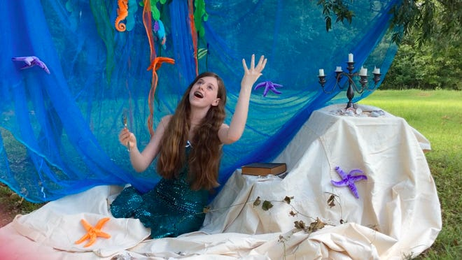 """Montford student Erin Broder pulled together a backdrop, scenery, props and a costume for her rendition of """"Part of Your World"""" from """"The Little Mermaid"""" in her yard."""